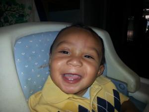 Kayden showing off 2 teeth laughing